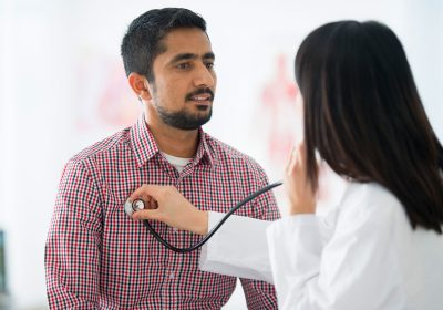 Latin American man receiving a medical examination