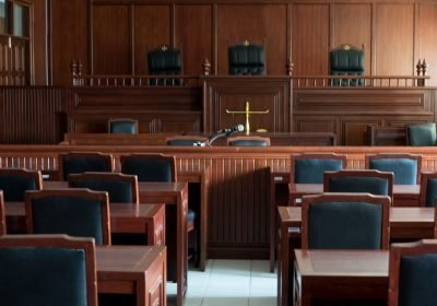 Empty courtroom facing the judge's stand