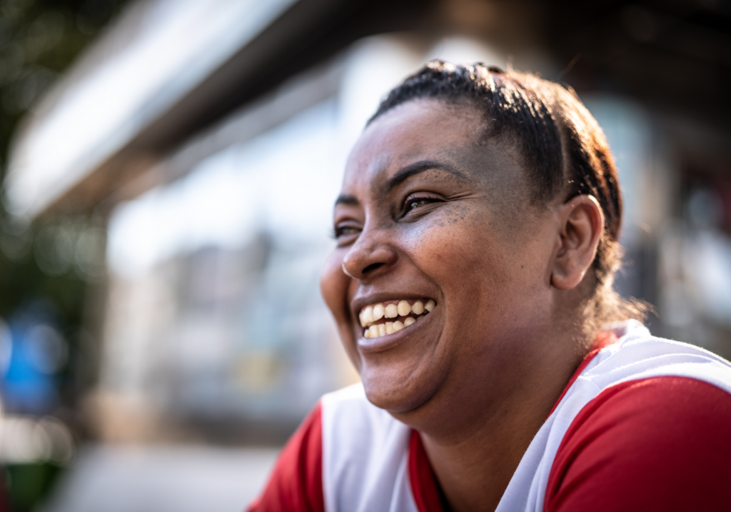 Portrait of Brazilian woman smiling on the street